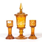 A Bohemian Amber Overlay Clear Glass Goblet Vase and Cover, mid 19th century, the panelled bowl
