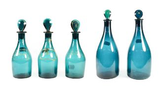 A Matched Set of Three Green Glass Spirit Decanters and Stoppers, early 19th century, of mallet