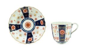 A Worcester Porcelain Large Coffee Cup and Saucer, circa 1770, of fluted form, painted with the