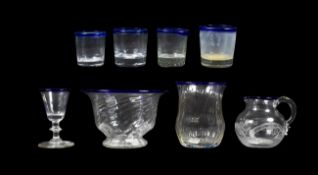 A Glass Sugar Bowl, circa 1800, of wrythen fluted ogee form with blue glass rim, 8.5cm high; A
