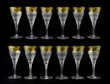 A Set of Twelve Moser Wine Glasses, late 20th century, with etched gilt rims over bands of geometric