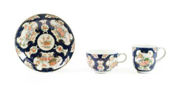 A Worcester Porcelain Trio, circa 1770, painted with the Queen's Japan pattern on a blue scale