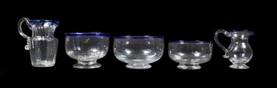 A Glass Cream Jug and Sugar Bowl, circa 1800, of fluted form with blue glass rims, jug 11cm high,