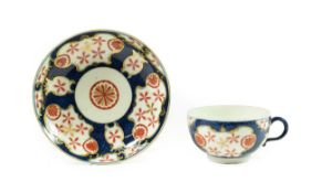 A Worcester Porcelain Teacup and Saucer, circa 1770, painted with the Queen's Japan Star pattern