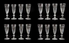 A Set of Eighteen Baccarat Champagne Glasses, modern, Harcourt pattern, with panelled conical bowls,