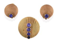 A Sapphire Brooch, of yellow textured circular form with four graduated round cut sapphires in