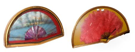~ Two fans in gilt framed wall hanging display cases, one faux tortoiseshell and ostrich feather,
