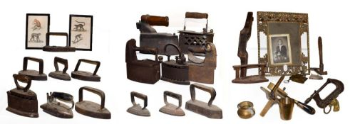 ~ A collection of metalwares, mainly flat irons and box irons, antique leather working tools