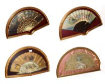 ~ Four fans each in a gilt framed wall hanging display case, comprising two with bone sticks and