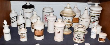 ~ A quantity of Spanish pottery and opaque glass apothecary jars and other storage vessels and