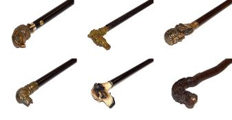 ~ An Oriental carved hardwood walking stick formed as a dragon and a collection of other walking