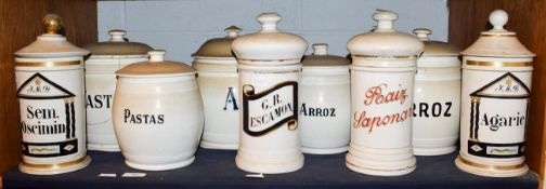 ~ A quantity of Spanish pottery food storage jars and covers with enamel and gilt lettering (1