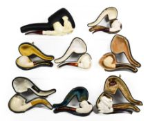 ~ A quantity of cased Meerschaum pipes, one formed as an owl, also including Turks and claws (1