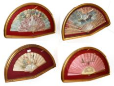 ~ Four fans each in a gilt framed wall hanging display case, including one decorated with a