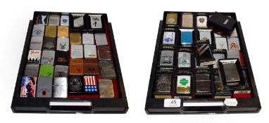~ A collection of Zippo lighters including advertising and leather mounted examples (2 trays)