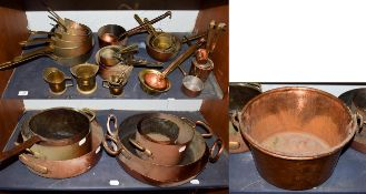 ~ A collection of mainly antique brass and copper cooking wares, including graduated pans and