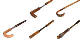 ~ Two bamboo sword sticks, two other sword sticks including one with a tigers eye pommel, together