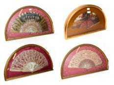 ~ Four fans with mother-of-pearl sticks, each in a gilt framed wall hanging display case, two lace