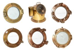 ~ Five brass ships portholes, two with glass, together with a brass cased marine compass on gimble