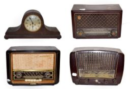 ~ An Invicta Bakelite valve radio, two Philips examples and an oak cased 8 day mantel clock striking