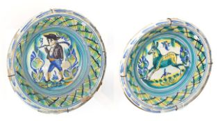~ Two large 19th century Spanish Talavera type tin glazed earthenware bowls, one decorated with a