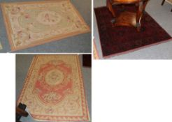 A Chinese ''Aubusson'' rug, the coral pink field centred by a floral medallion, framed by narrow
