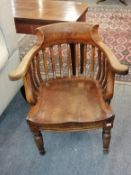 A 19th century oak High Wycombe armchair, rail stamped 1664/114