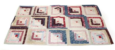 Late 19th Century Log Cabin Cot Quilt, the small red square to the centre depicts a fire in the