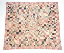 A Large 19th Century Patchwork Quilt, comprising a central square with small frames around a four
