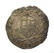 The Commonwealth, 1652 Shilling. 5.91g, 32.1mm, 9h. Obv: Shield with English arms. Rev: Shields with