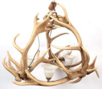 Antler Furniture: A Red Deer Antler Mounted Chandelier, circa mid-late 20th century, constructed