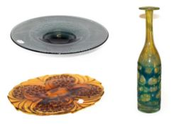 A Mdina glass bottle vase, 33cm, an amber moulded glass dish, 39cm and a smokey glass pedestal