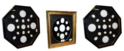 A collection of Grand Tour plaster intaglio seal casts, in a gilt frame and in a pair of octagonal