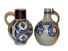 Two 18th century German Westerwald salt glazed stoneware flagons, one with a Royal monogram GR,
