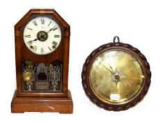 A Seth Thomas mantel clock with alarm function, together with an oak cased wheel barometer with