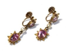 A pair of early 19th century pink tourmaline and seed pearl drop earrings, the oval cut pink
