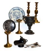 A tray of 19th century metalwares, including a Niello plate, two pairs of brass candlesticks