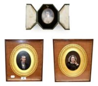 An oval portrait miniature of a lady in fitted leather easel case circa 1920, together with a pair