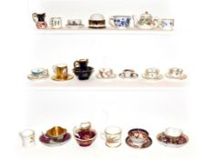 A collection of porcelain miniatures to include a King Street Derby dolls house teapot and cover,