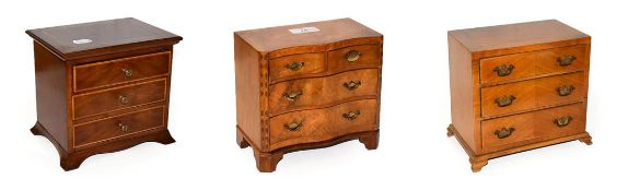 A walnut jewellery casket formed as a serpentine chest of drawers, crossbanded in mahogany,