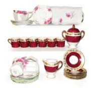 A Shelley Queen Anne part tea set decorated with poppies and a Wedgwood part coffee set (one tray)