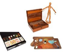 An artist's dummy with jointed limbs, a Winsor & Newton watercolour tin, mahogany Reeves & Sons