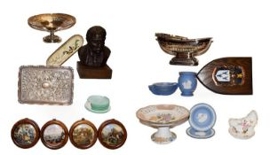 A group of items including a resin bust, decorative coat of arms, pot lids, ceramics and toys,