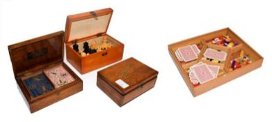 A mid 20th century games compendium, chess set in box, together with two bezique cabinets, one