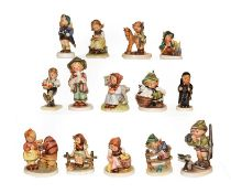 A tray of fourteen Hummel figures . Three figures damaged the remainder in generally good condition
