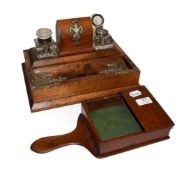 An Edwardian oak desk standish with a pair of cut glass inkwells, together with a mahogany offertery