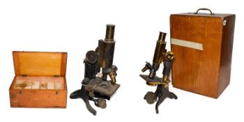 A cased microscope by Baker, another by makers J Swift, cased quantity of microscope slides and