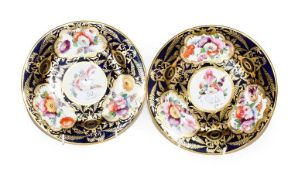 A pair of early 19th century English porcelain plates, Coalport style, decorated with floral sprays,