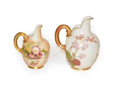 Two Royal Worcester blush ivory jugs, both painted with flowers, both model 1094, tallest 17cm high.