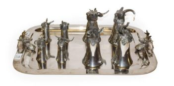 Eight silver plated zoomorphic stirrup cups on tray by Kenneth Turner
